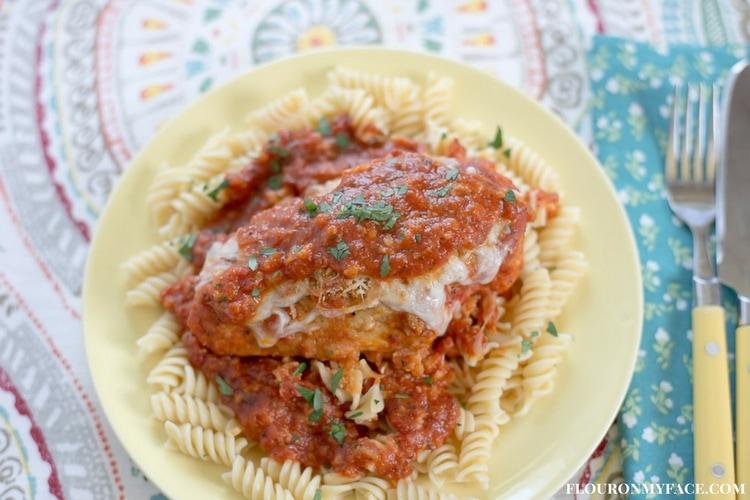 Easy Chicken Parmesan recipe made in the crock pot via flouronmyface.com