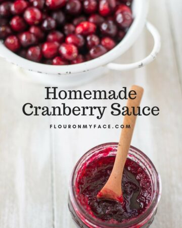Homemade Cranberry Sauce recipe in a canning jar with a colander full of fresh cranberries