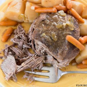 Crock Pot Pot Roast is moist and tender. Served with potatoes and carrots.