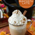 Mug filled with Crock Pot Pumpkin Spice Rum Chata Latte topped with whipped cream.