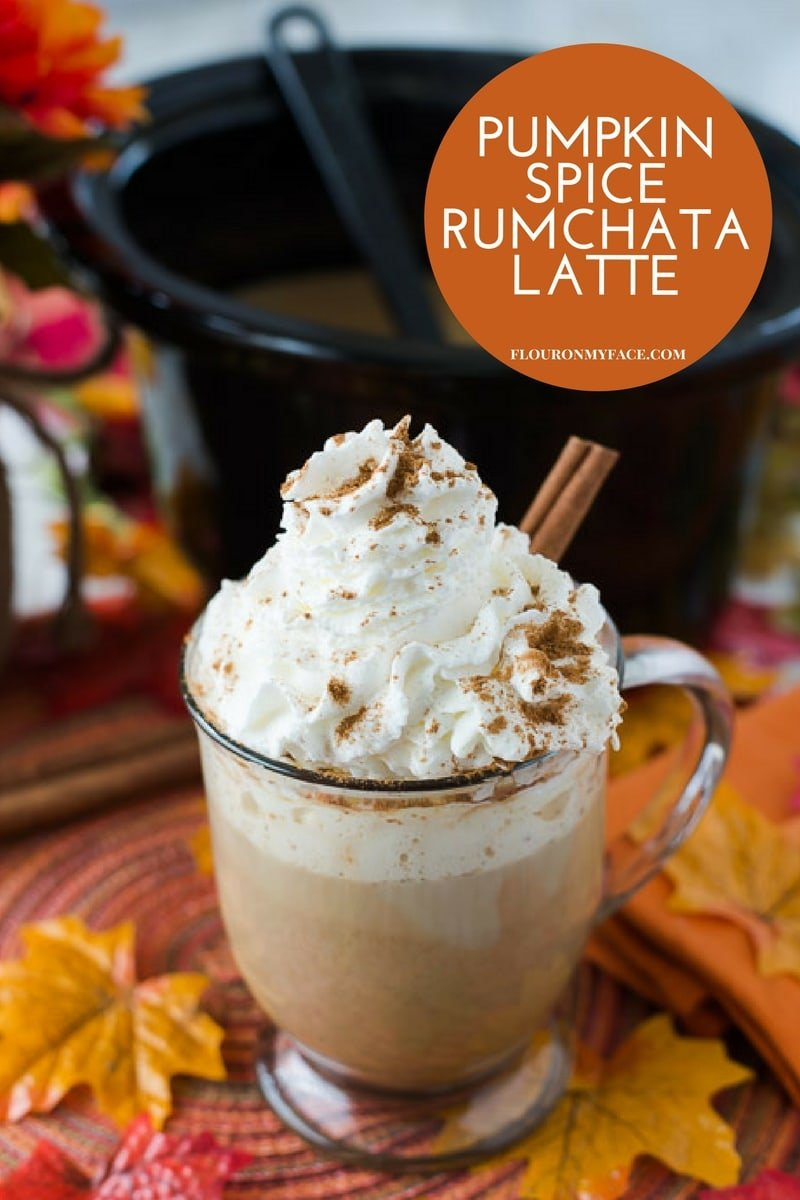 Mug filled with Crock Pot Pumpkin Spice RumChata Latte topped with whipped cream.