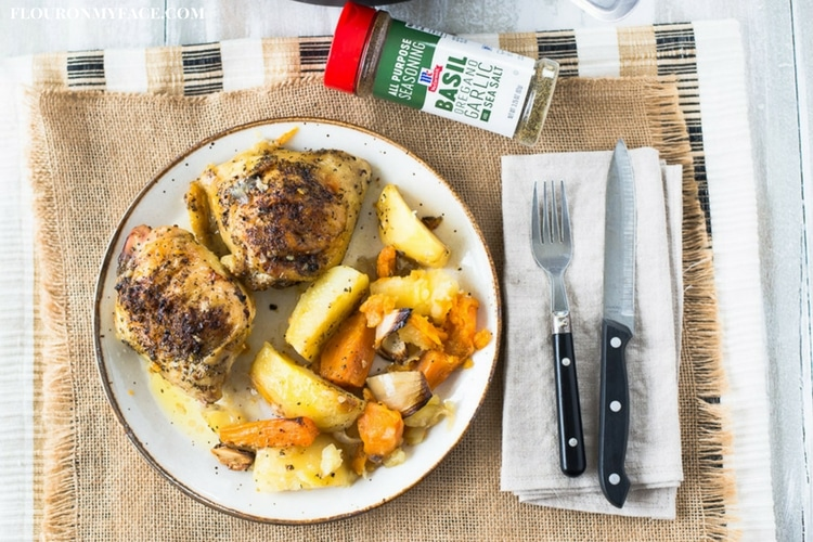 Easy Greek Chicken Recipe served on a cream colored plate with potatoes, sweet potatoes, onion and garlic