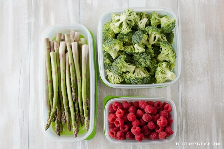 Fresh raspberries, asparagus, and broccoli in the Rubbermaid FreshWorks produce containers.