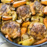 Greek Style Roasted Chicken with potatoes served in a skillet