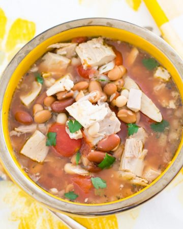 Overhead photo of a soup bowl filled with Three Bean Turkey Soup