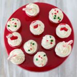 Holiday Sugar Cookie Cupcakes Bites recipe over head photo on a red cake stand
