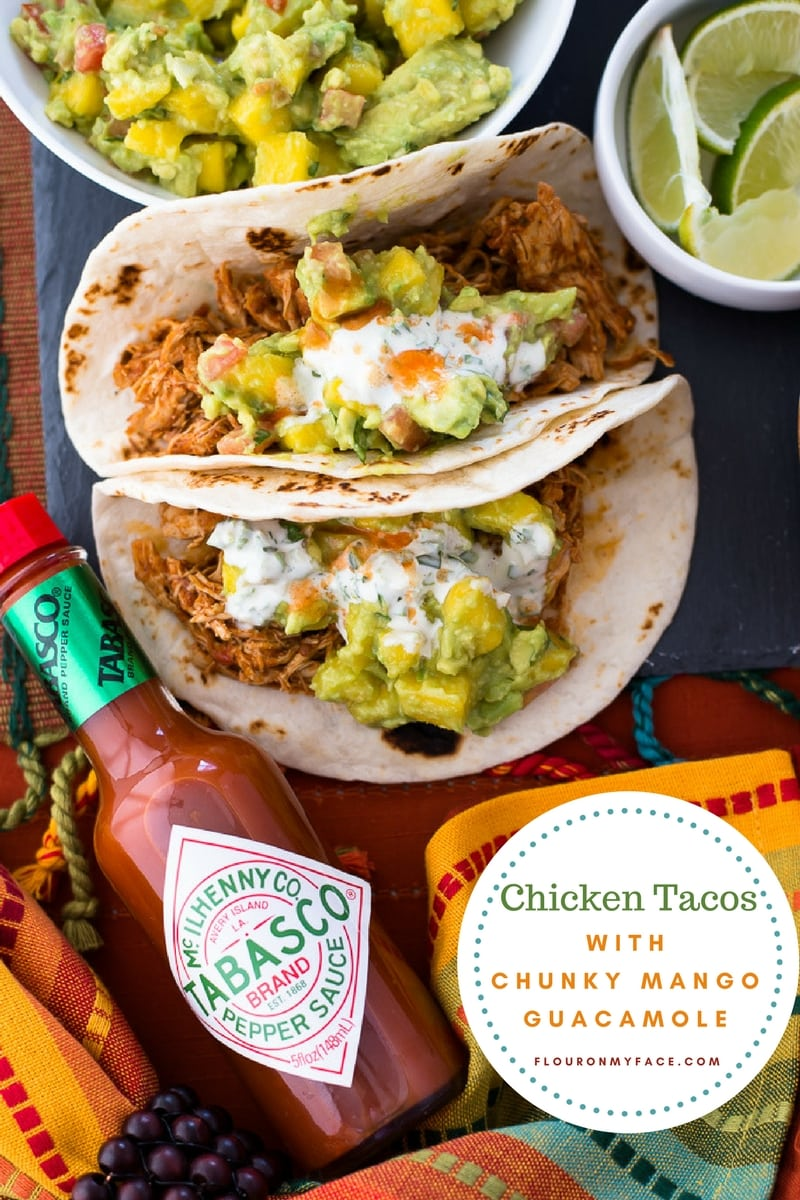 Easy Instant Pot Chicken Tacos with homemade Chunky Mango Guacamole topped with Spicy Jalapeno Sauce and TABASCO sauce
