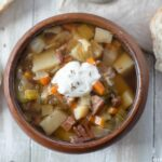 Ham Cabbage Potato and Fennel Soup recipe served in a wooden bowl.