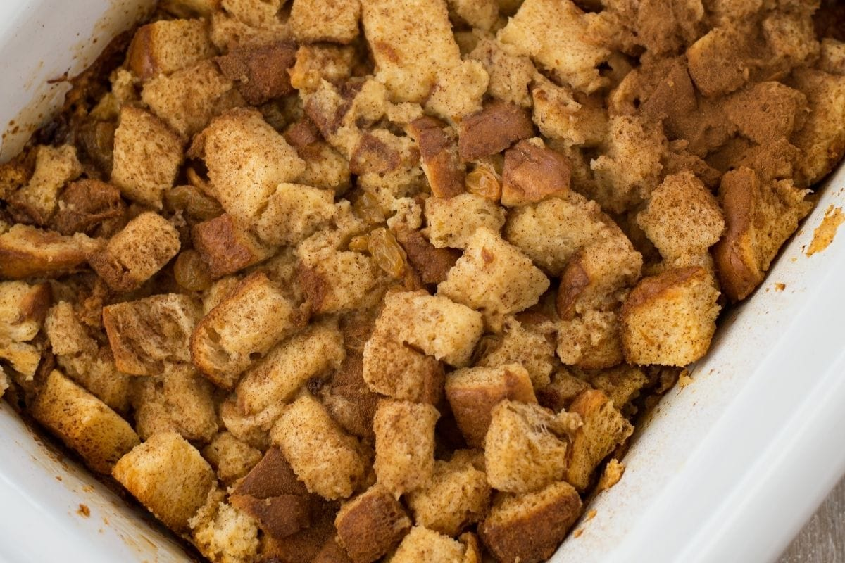 Slow cooked bread pudding inside a casserole crock pot.