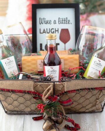 Closeup of a wine gift basket filled with wine themed gifts.