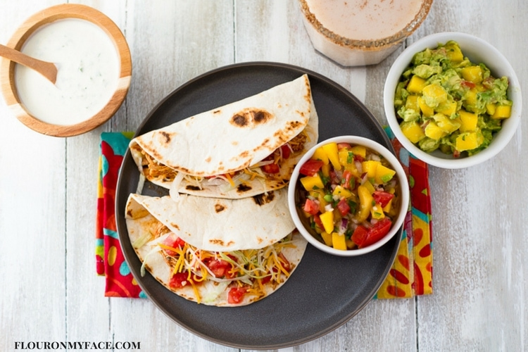 3 Ingredient Instant Pot Chicken Tacos filling served with homemade salsa.