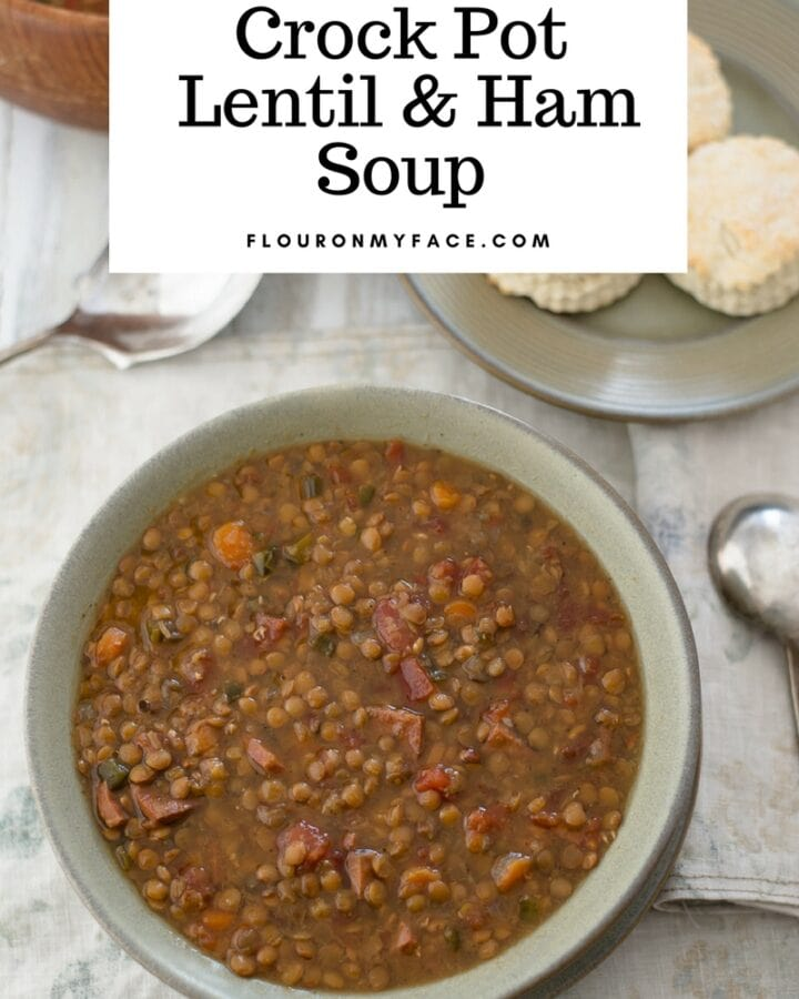 Crock Pot Lentil Ham soup recipe in a soup bowl served with fresh made biscuits.