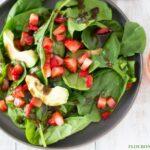 Homemade Balsamic Vinaigrette recipe served over a bowl of Spinach, Strawberry and Avocado Salad.