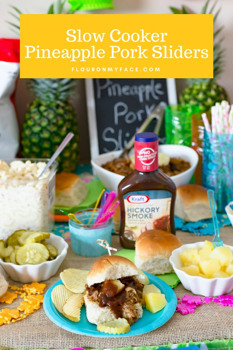 Slow cooker Pineapple Pulled Pork Sliders serve at a Luau themed family game night on the party food table.