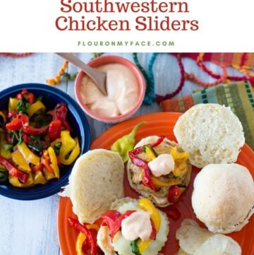 Game Day food on the table with Southwestern Chicken Sliders, airfryer bell peppers, Sriracha mayonnaise on a orange Fiesta-ware plate.