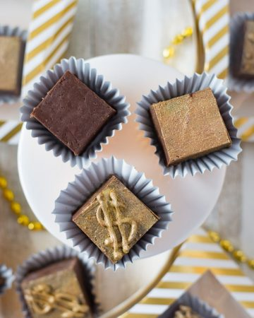 3 pieces of decorated fudge squares.