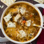 Crock Pot Pumpkin Turkey Chili recipe served with sour cream, shredded cheddar cheese and saltine crackers.