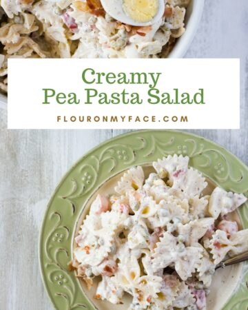 A Creamy Pea and Pasta Salad recipe in a white serving bowl on a plate with green trim