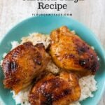 A bowl of Crock Pot Honey Garlic Chicken Thighs served over a bed of cooked white rice.