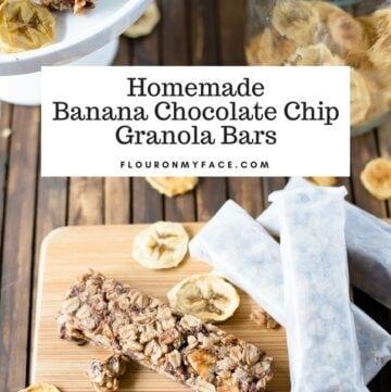 Homemade Banana Chocolate Chip Granola Bars wrapped in parchment paper on a wooden cutting board.