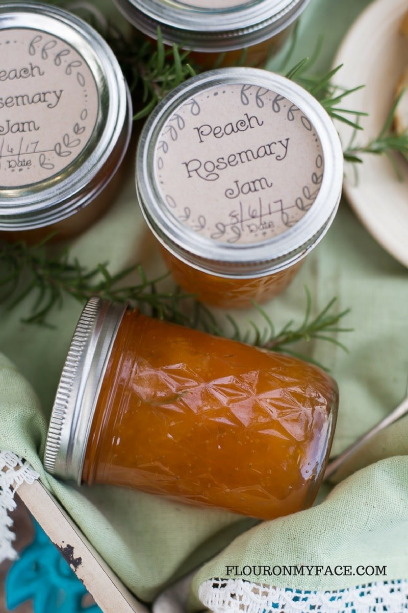 Peach Rosemary Jam on a serving tray in Ball mason jars