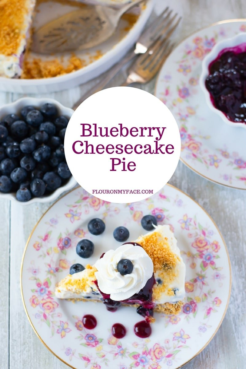 Blueberry Cheesecake Pie recipe made with 2 layers of blueberry flavored cheesecake and topped with homemade blueberry sauce.