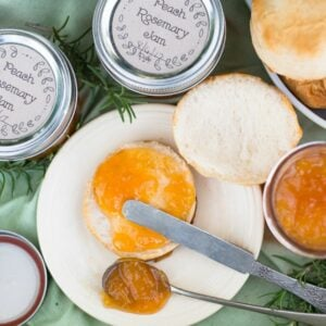 Sweet and spicy Peach and Rosemary jam spread on a biscuit.