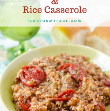Crock Pot Italian Ground Beef and Rice Casserole served in a green bowl with a glass of water and fresh rolls.