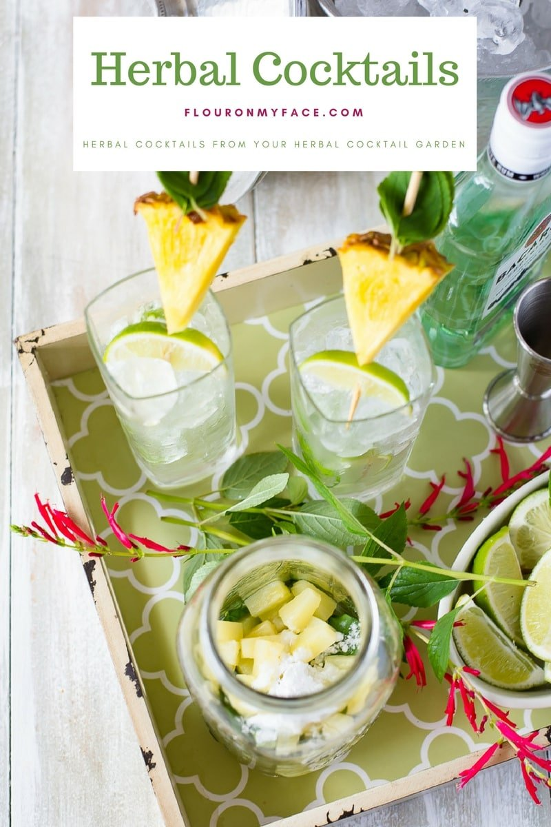 Herbal Pineapple Mojitos served with fresh mint, pineapple and lime wedges.
