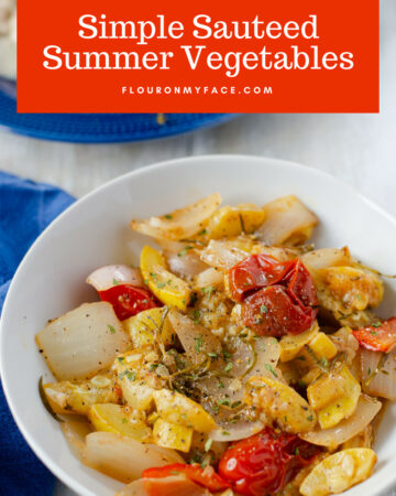A white serving bowl with simple sauteed summer vegetables recipe.