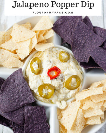 Crock Pot Jalapeno Popper Dip recipe served with white and purple tortilla chips