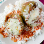 Easy and simple crock pot Stuffed Bell Peppers recipe served over a bed of white rice. Tips on cooking perfect white rice every time.