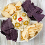 Slow Cooker Jalapeno Popper Dip recipe served with tortilla chips.
