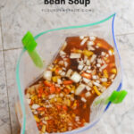 Freezer Meal Sausage Garbanzo Bean Soup recipe with crock pot and stove top cooking directions.