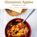 A brown bowl filled with Instant Pot Cinnamon Apples and a sliced pound cake on a wooden cutting board.