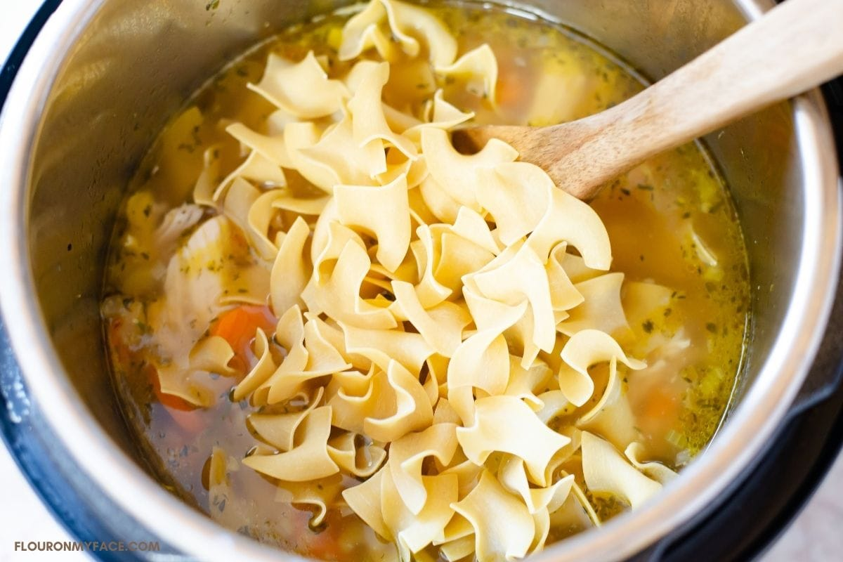 Uncooked egg noodles added to the soup.