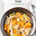 Crock Pot Chicken Roasted Sweet Potato Soup in a blue hand turned pottery bowl