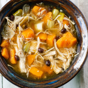 A bowl of Crock Pot Chicken and roasted vegetable soup