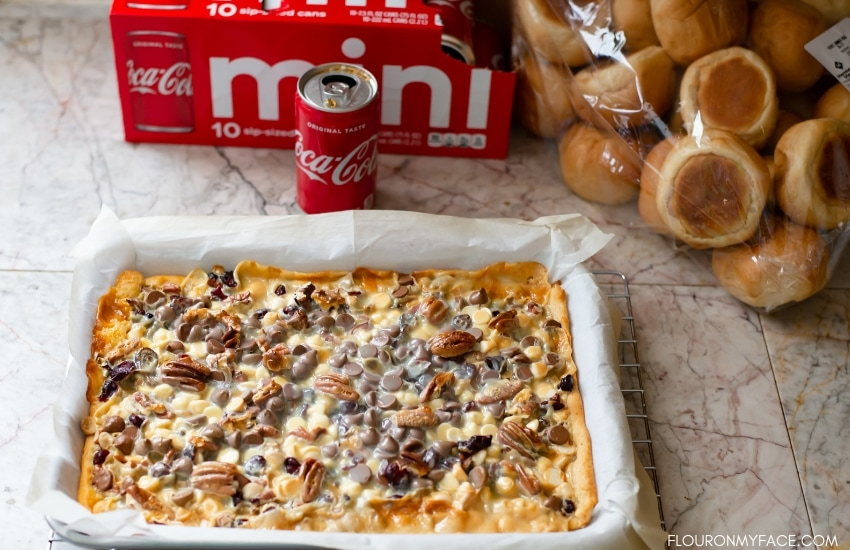 Holiday shopping at Sam's Club for everything you need for your holiday celebration. Coke Mini, Sam's Club Dinner rolls and the ingredients for Cranberry Pecan Dessert Bars