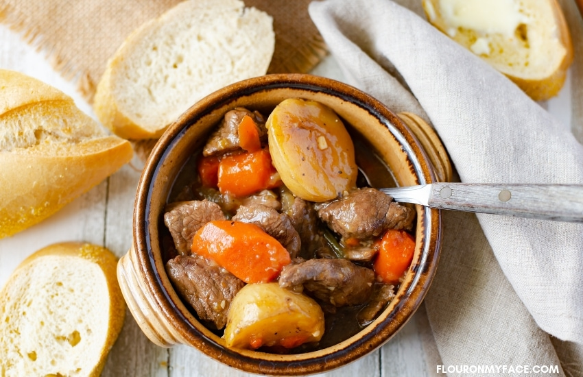 A brown pottery bowl of Hearty Beef Stew