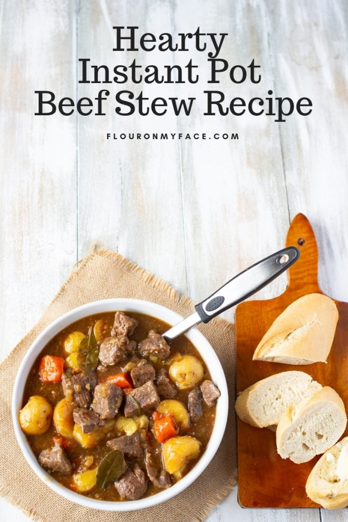 Hearty Instant Pot Beef Stew recipe served with crusty French bread to sop up the thick, delicious gravy