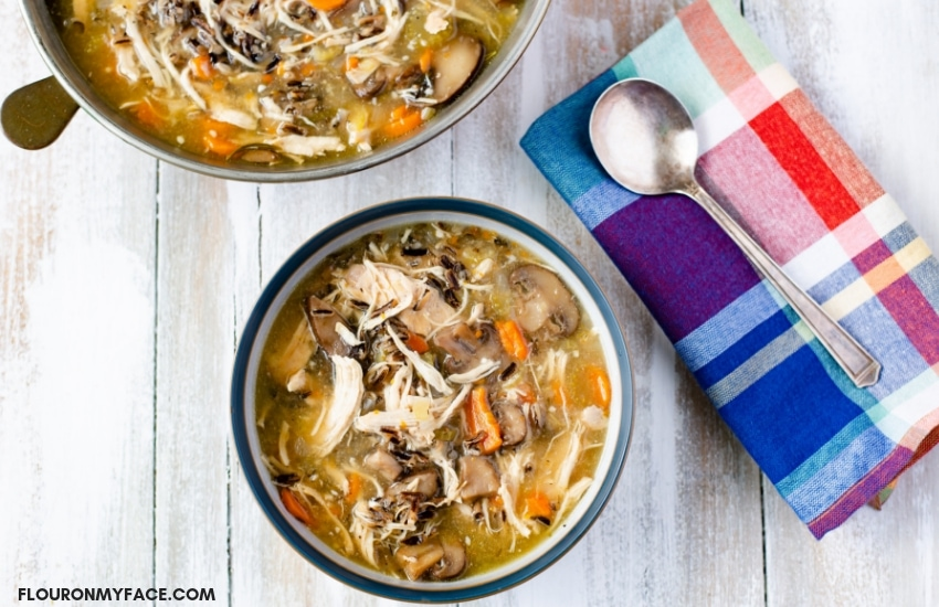 A blue bowl of Instant Pot Chicken Wild Rice Mushroom Soup recipe