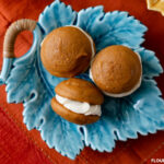 Teal blue fall leaf shaped serving platter with 3 pumpkin spice whoopie pies