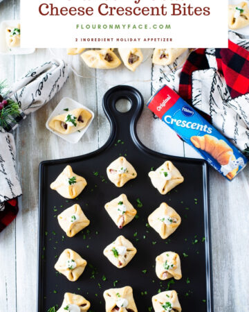 Cranberry Goat Cheese Crescent Bites on a black appetizer tray