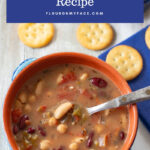 Crock Pot Spicy Bean Soup served in a blue terra cotta bowl with crackers.