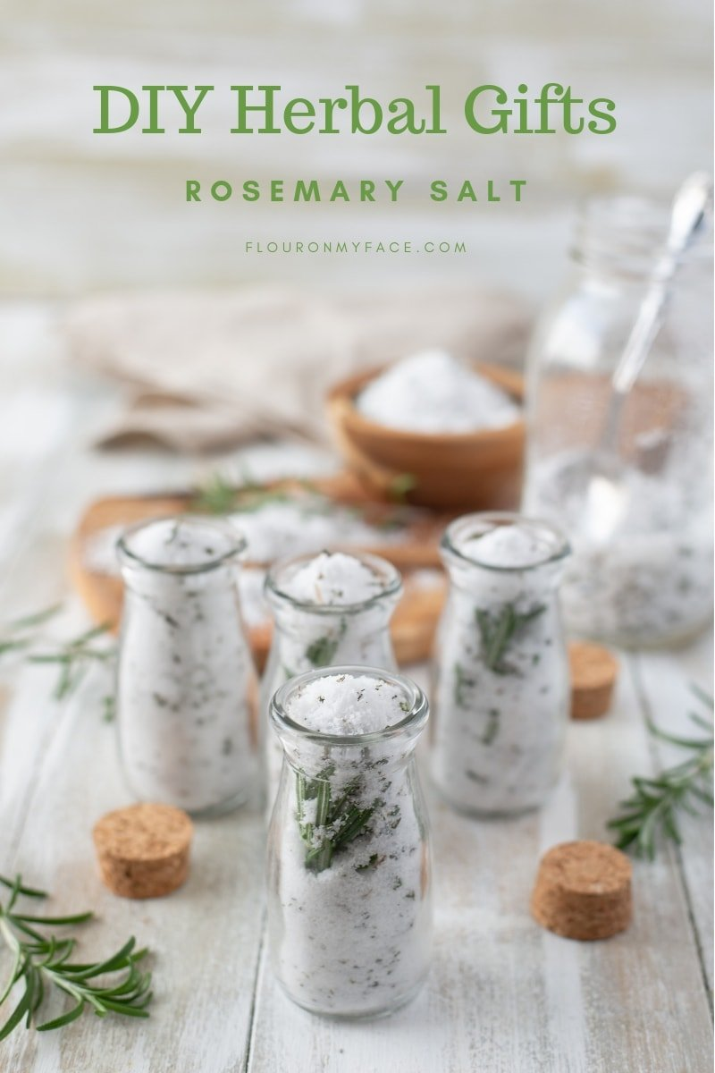 Bottles being filled with homemade rosemary salt for edible gifts during the holidays