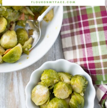 A white serving bowl of pressure cooked Instant Pot Brussels Sprouts