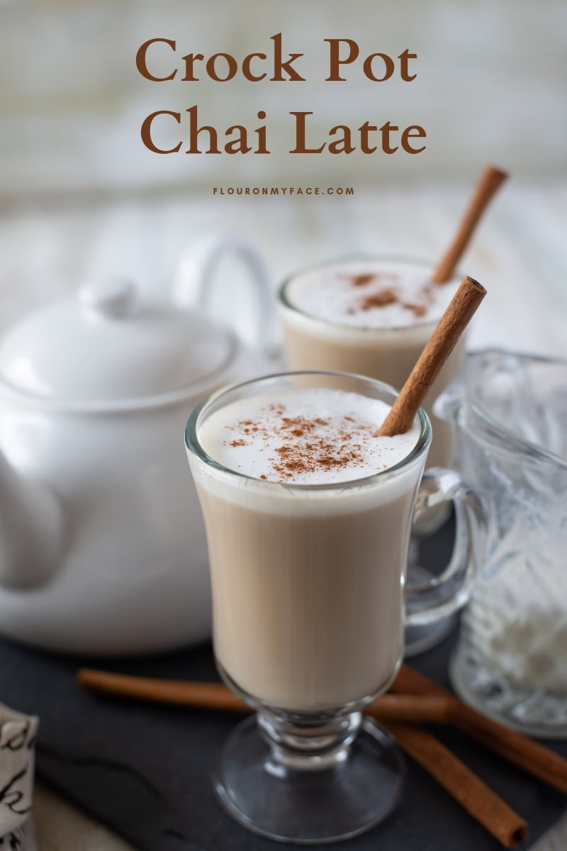 Crock Pot Chai Latte served in a tall mug, topped with frothed milk and garnished with a cinnamon stick.