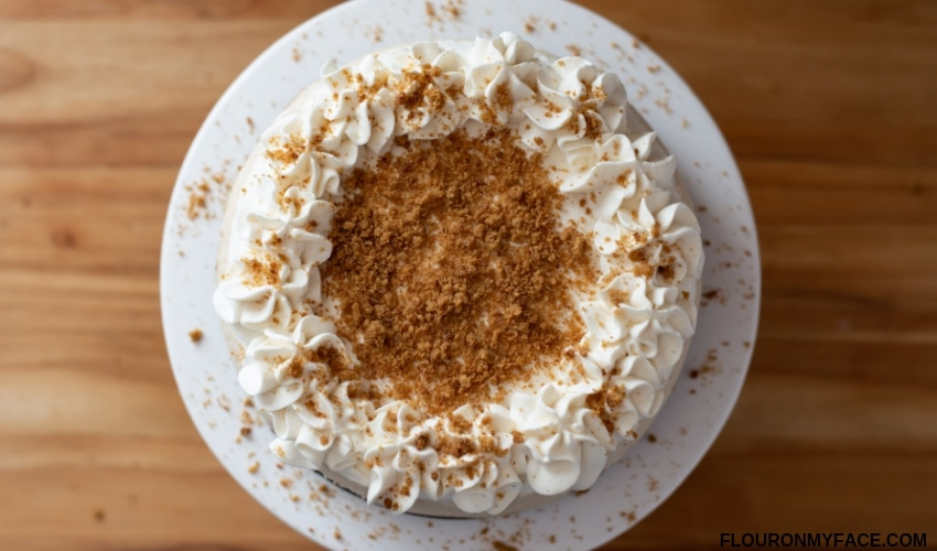 Holiday Eggnog Cheesecake recipe on a cake stand