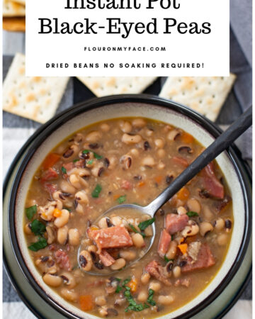 Bowl of Instant Pot Black Eyes Peas recipe on a black and white cloth napkin served in a grey bowl with a black border.